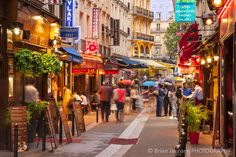 Shops tourists Rue Saint-Severin Latin Quarter Paris France. You could spend all day looking through the gorgeous photos of Paris on Brian Jannsen's site.