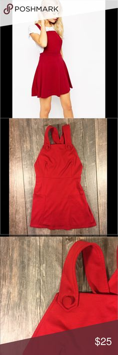 Asos red overall dress Asos red overall dress. Pockets. Buttons at braces. Zipper in back. 33.5 inches long. See pic for piling example, couple areas due to rubbing. Polyester 3% elastane. Tag reads size 6. #4 ASOS Dresses