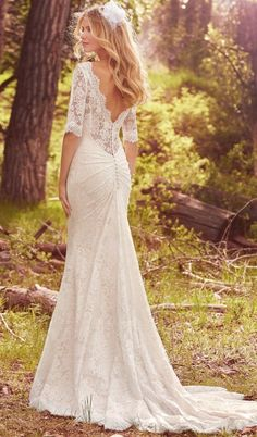 Sleeved styles are a huge wedding dress trend in 2017 and 2018. Save Mckenzie, an elbow-length sleeved wedding dress by Maggie Sottero, to your dream wedding board! This gown will fit perfectly into your festival wedding.