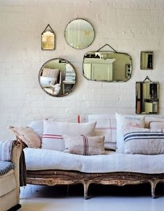 mirror gallery wall and grain sack pillows; Old Mirrors, Vintage Mirrors, Mirror Mirror, Mirror Collage, Hanging Mirrors, Mirror Ideas, Mirror Walls, Retro Mirror, Decoration Home