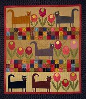 Joined at the Hip - Books.  Sorry I am not a cat person but this quilt is too cute not to pin.
