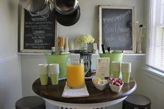 Fun beverage station - minus the booze of course! And love the chalkboards behind, one has the menu I think?