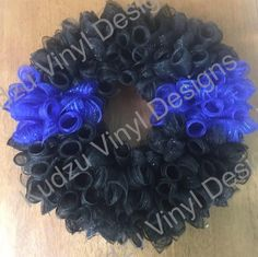 Support your local Law Enforcement with our Thin Blue Line Deco Mesh Wreath. These can be personalized for an additional fee. check out all of our Wreath Designs @: www.kudzuvinyldesigns.com