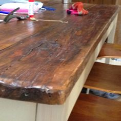 A picture of a table made from old scaffold boards. Soft edge of wood