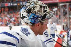 CALGARY, AB - MARCH 13: James Reimer #34 of the Toronto Maple Leafs takes a break at the bench between whistles against the Calgary Flames at Scotiabank Saddledome on March 13, 2015 in Calgary, Alberta, Canada. (Photo by Gerry Thomas/NHLI via Getty Images)