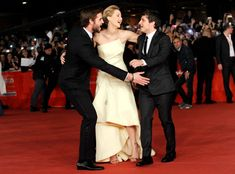 Liam Hemsworth, Jennifer Lawrence, Josh Hutcherson: The adorable trio reunite for the Rome premiere of The Hunger Games: Catching Fire.