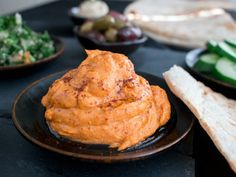 Better than Store Bought Red Pepper Hummus is a delicious savory, slightly spicy creamy garbanzo (chickpea) dip. (gluten-free, vegan)