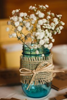 Blue mason jars filled with baby's breath, wrapped with burlap. I would probably choose a different flower to be in the jars. I love blue mason jars though! Mason Jar Centerpieces, Rustic Wedding Centerpieces, Teal Wedding Decorations, Teal Centerpieces, Centerpiece Flowers, Centerpiece Ideas, Wedding Jars, Wedding Table, Wedding Ideas