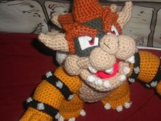 Mario Bowser Amigurumi Pattern- there are a ton of free game character amigurumi patterns at this site!