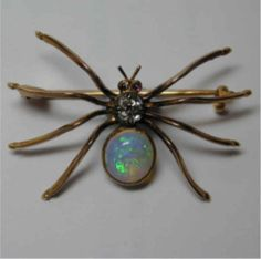 A Victorian English Opal and Diamond spider brooch.