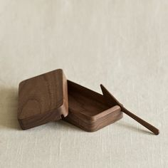 Designed by Oji Masanori and handcrafted at the Takahashi Kougei wood workshop in Hokkaido. The Kakudo butter dish keeps your butter neat and ready to spread on your toast. The lid fits perfectly atop the dish with 45-degree angled edges.  Available in small and medium. The small dish may also be used as a jewelry or trinkets box. The medium dish comes with a matching butter knife.
