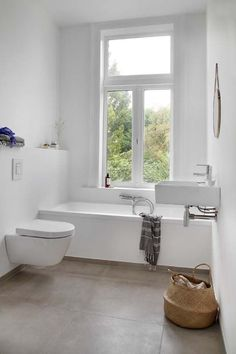 Stylish And Laconic Minimalist Bathroom Decor Ideas. Badezimmer einrichten Interior Design weiß und Beton
