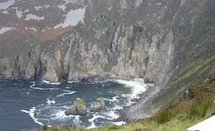"""Slieve League on the northwestern coast; the second-highest cliffs in Ireland. The breathtaking view is well worth the hike to get there. You can drive, but the road is very narrow and it's really so much more enjoyable to see it while walking. Sheep dot the landscape near the cliff's edge."""