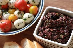 """Black Olive Tapenade (6 servings) : : : This stellar recipe for tapenade comes from the """"Barefoot Contessa"""", Ina Garten. You may reduce the number of anchovy fillets recommended. Don't be put off by this secret ingredient…it really compliments the olive flavor."""