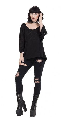 Keep fashionable and warm with Skull Knit Hoodie. This slightly oversized loose hoodie is perfect to wear over top a tank top or T-shirt and those days when you need a little more warmth. An all over black-on-black pattern of skulls is subtle print but shines when the light catches it. Sleeves are long ending just above to wrist. The front ends just at the hip and is longer in the back. The scoop neck leads to the large hood, which has a drawstring to adjust.