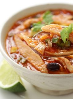 One of Skinny Mom's most popular soups, the Slow Cooker Chicken Tortilla Soup. It's healthy and your whole family will love!