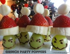 Grinch Party Poppers from Creative Kid Snacks.  For a Christmas party or as a snack or theme day when watching The Grinch movie.  Made of sliced white string cheese, strawberry, sliced banana, green grape (bottom sliced off so it lays flat)  melted chocolate (1/2 of a Hershey's bar is enough to make 25 poppers).  Used plastic toothpicks with hearts on the top to hold together.