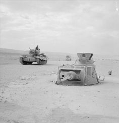 The gun turret of a Matilda tank that had been captured and concreted into position to be used as part of the defences of Halfaya Pass, 16 March A Valentine tank passes by in the background. Afrika Corps, North African Campaign, Gun Turret, Armored Fighting Vehicle, Ww2 Tanks, British Army, British Tanks, Panzer, World War Two