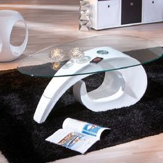 Coisa Modern #CoffeeTable in free flowing Shape and a trendy design. It is made of white fiber glass with #table top is of transparent safety glass.