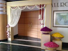 Simple yet elegant venue entrance decor!
