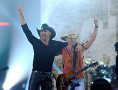 Tim McGraw Photos Photos - Musician Tim McGraw (L) and Kenny Chesney perform onstage at the 47th Annual Academy Of Country Music Awards held at the MGM Grand Garden Arena on April 1, 2012 in Las Vegas, Nevada. - 47th Annual Academy Of Country Music Awards - Show