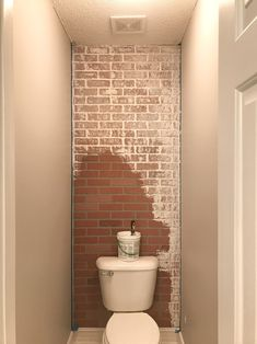 Your guide to turning your house into a home. one DIY project and yard sale find at a time Faux Brick Wall Panels, Fake Brick Wall, Brick Wall Paneling, Brick Accent Walls, Faux Walls, Brick Wallpaper Accent Wall, Painted Brick Walls, Brick Wall Bedroom, Brick Bathroom