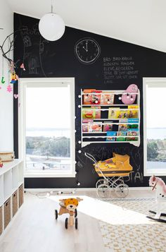 Kids playroom with blackbird walls and colourful shelves | kids rooms