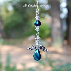 Iris blue hanging angel car charm or window decoration. Offering hanging angels in others colors with quality craftsmanship and fast shipping.
