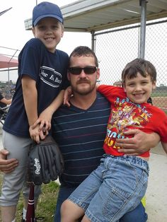 My brother Steven and his boys at Drew's baseball game.