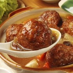 These homemade pork meatballs are glazed in a sweet and sour sauce.