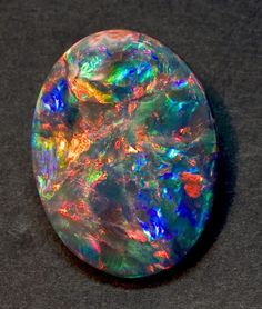 Geology IN: 10 Most Rare Gemstones in the World Rarer than a Diamond - Opal-black2.jpg 393×463 pixels
