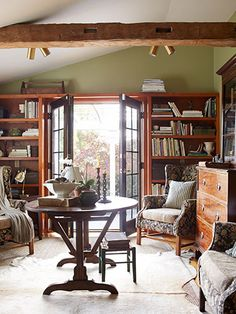 Rustic Library Style In the library of this New York home, the owner unified mismatched wingback chairs with floral brocade upholstery and burlap cushions. The walls are painted Spanish Moss by Restoration Hardware. My Living Room, Living Area, Living Room Decor, Living Spaces, New York Homes, Home Libraries, Step Inside, Restoration Hardware, Rustic Style