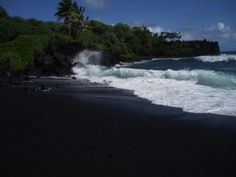 Take a trip to the dark side at this black sand beach!