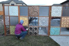 funky metal fence made from tin ceiling tiles and corrugated metal