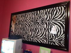 Giant zebra bulletin board! Teen bedroom - tween art - made from the following: carpet remnant (back facing forward) covered with fun fabric and trimmed with window trim bought at Lowes and painted.