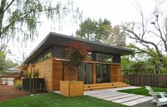 Sit back and relax in this contemporary container home's brightly-lit living area Modular Homes, Prefab Homes, Modular Housing, Factory Built Homes, Casa Top, Living Treasures, Cedar Siding, Construction Cost, Energy Efficient Homes