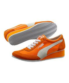 Take a look at this Orange Popsicle Caroline Wedge Sneaker - Women by PUMA on #zulily today! $35 !!