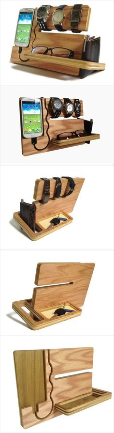 """Super cool accessory caddy; love the design. (There's a cup for keys & coins on the back.) """"Watch and Eye Dock Galaxy S4 S3"""" by undulatingcontours on Etsy, $42:"""