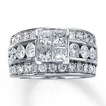 14K White Gold 3 1/2 Carat t.w. Diamond Ring  Four dazzling princess-cut diamonds take center stage in this alluring ring for her. An impressive array of round diamonds sparkles along the band of 14K white gold. 3 1/2 carats total weight. Also available at select Jared locations—call 1-800-527-8229 for the store nearest you.
