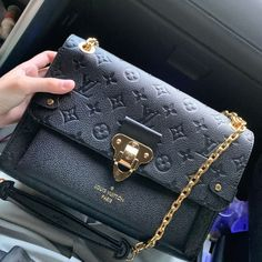 Unstructured throw-over-your-shoulder or tuck-under-your-arm bags have always been a favourite for t. Louis Vuitton Keepall, Louis Vuitton Speedy, Louis Vuitton Handbags, Purses And Handbags, Vintage Louis Vuitton, Louis Vuitton Designer, Designer Bags, Designer Handbags, Luxury Bags