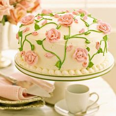 This rose and vine covered cake is almost too pretty to eat. The three-layer yellow cake has a velvety crumb and buttery taste.