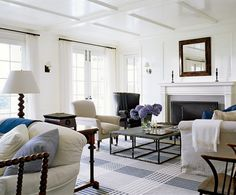 Top 5 living rooms:  Victoria Hagan designer - love the fireplace and the simplicity of the mantle; love the rug, the coffee table with the hydrangeas, the English sofa, the French doors; the coffered ceiling and the glossy white paint;   Floor lamp's shape lends texture to the room
