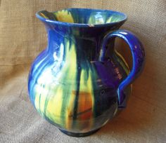 Hey, I found this really awesome Etsy listing at https://www.etsy.com/listing/170475130/vintage-mexican-pottery-dripware-pitcher