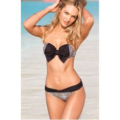 Cheetah and black bow Victoria secret bikini top This strapless top is perfect for any one who swims. It is a size 34C Victoria's Secret Swim Bikinis