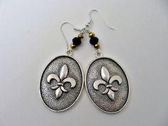 NFL New Orleans Saints Football Dangle by SportsJewelryStudio.  etsy.com/shop/sportsjewelrystudio.  $14.00