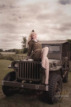 Here is a styled vintage image of a Willys Jeep and a Beautiful Pin Up model in Army uniform sitting on the bonnet. Approximate sizes Mount H x W Image H x W Model:- Rosie Lea Jeep Willys, Willys Wagon, Jeep Concept, Military Jeep, Jeep Wave, Army Uniform, Pin Up Models, Vintage Images, Pin Up Girls