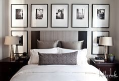 Black and white gallery frames over headboard