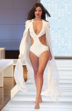 Miranda Kerr models the latest swimwear creations on the catwalk for Australian department store David Jones