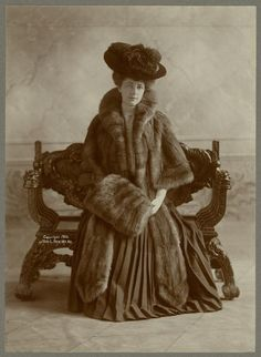 Woman wearing fur cape with fur muff, ca. 1906.  New York Public Library