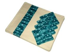 Blue waves style set of placemats and coasters. One set available from: https://www.etsy.com/uk/listing/177147511/set-of-4-placemats-and-coasters-made? #patchwork #placemats #homefurnishings #bluewaves